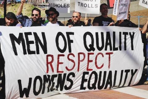 """At 2017 Women's March in Los Angeles, group of men holding a sign that says, """"Men of quality respect women's equality."""""""
