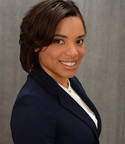 Headshot of Fatima Smith in white blouse and navy suit jacket.